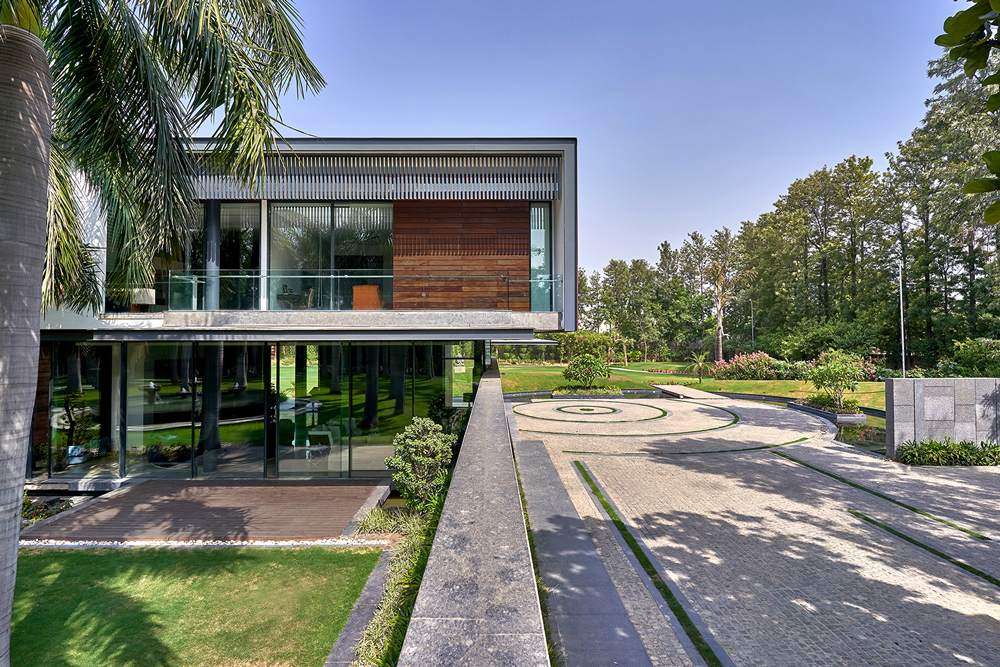 Beautiful landscaping meets understated luxury at Palm Grove by DADA and Partners